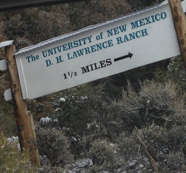 Sign that reads The University of New Mexico D.H. Lawrence Ranch 11/2 miles
